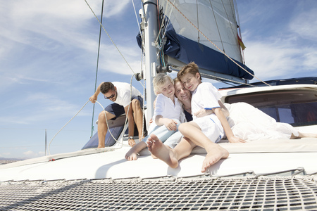 Parents and two sons on catamaran near Fuerteventura, Spain LANG_EVOIMAGES