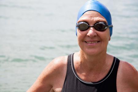 Close up portrait of senior woman swimmer in sea