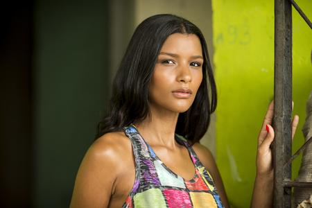 marta: Portrait of sultry young woman, Favela Santa Marta, Rio de Janeiro Brazil