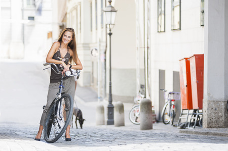 Portrait of mid adult woman with bicycle