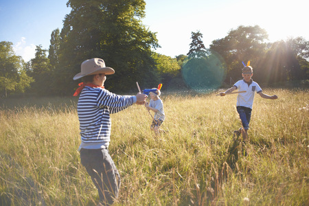 only boys: Group of young boys playing in a field