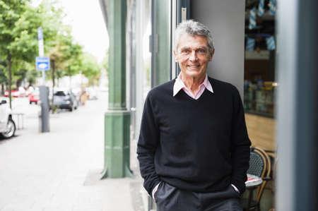 65 69 years: Portrait of smiling senior man at sidewalk cafe LANG_EVOIMAGES