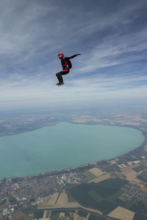 Female skydiver free falling above Siofok, Somogy, Hungary LANG_EVOIMAGES