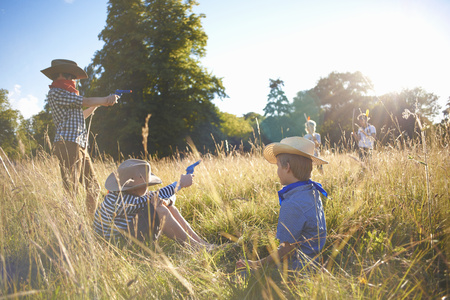 Group of young boys playing in a field
