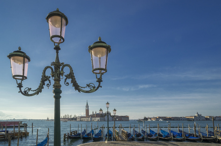st  marks square: Gondolas and the Island of San Giorgio Maggiore, from St Marks Square, Venice, Veneto, Italy LANG_EVOIMAGES