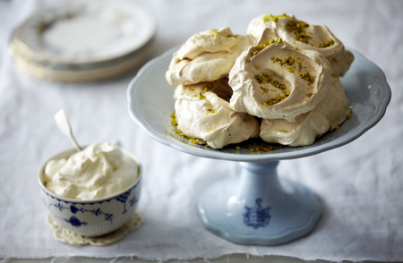 Meringues on dessert plate LANG_EVOIMAGES