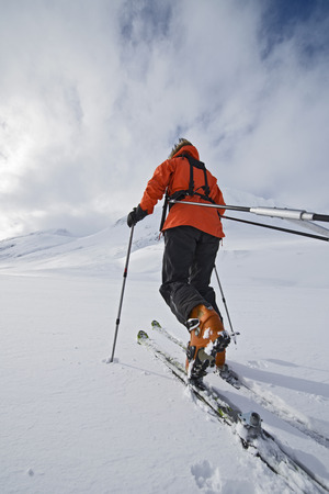 Female touring skier pulling an expedition sled in snow, Oxnadalsheidi, North Iceland, Iceland
