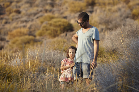 Father and daughter standing on hillside,Almeria,Andalusia,Spain