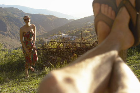 25 35: Young woman and selfie of mans legs,Sierra Nevada,Andalucia Granada,Spain