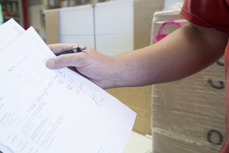 50 54 years: Hand of male warehouse worker collecting order for hardware store