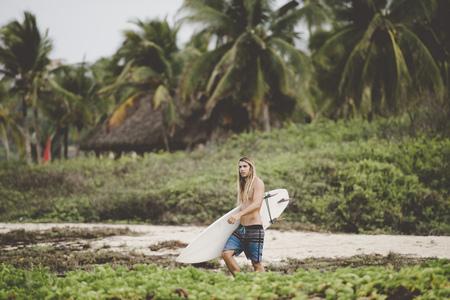 Australian surfer with surfboard,Bacocho,Puerto Escondido,Mexico