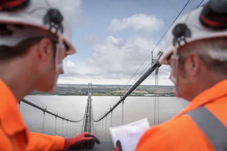 50 54 years: Bridge workers on top of suspension bridge. The Humber Bridge, UK was built in 1981 and at the time was the worlds largest single-span suspension bridge LANG_EVOIMAGES