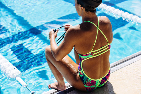 Swimmer sitting at end of pool