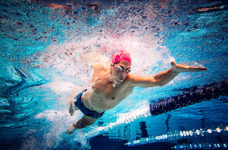 Swimmer doing freestyle in lane LANG_EVOIMAGES