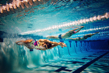 Swimmers doing freestyle in lane