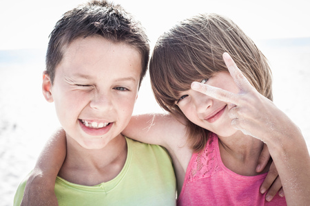 Brother with sister making peace sign
