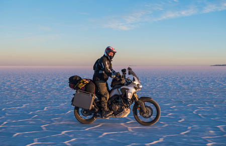 one mature man only: Man riding motorcycle on the salt flats of Uyuni,Potosi,Bolivia,South America
