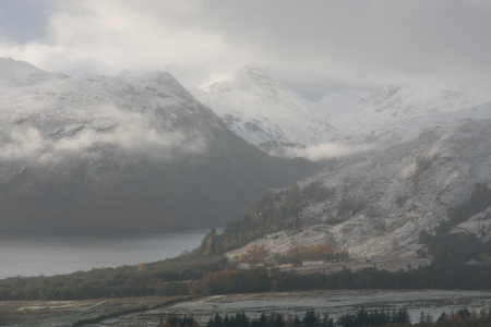 cumbria: Low cloud and snow capped mountains at Ullswater,The Lake District,UK