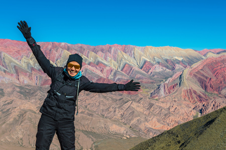 Portrait of woman in motorbike gear at the colourful mountains of Humahuaca,4,300m altitude,Jujuy,Argentina,South America