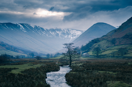 Storm clouds over snow capped mountains at Martindale,The Lake District,UK LANG_EVOIMAGES