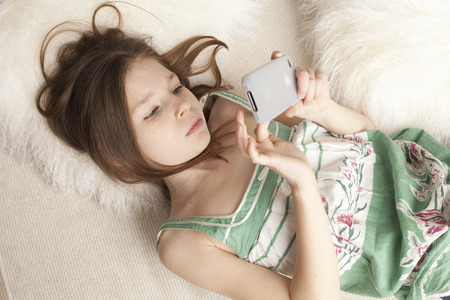 pubescent: girl playing game on a phone