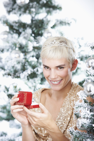 attractiveness: Woman holding a christmas gift