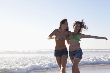 Two girls running on beach