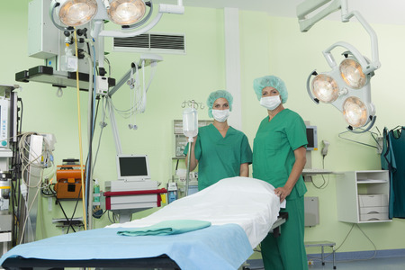 power operated: Nurses with scrubs in operation room