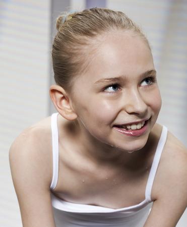 saturating: Smiling girl washing her face