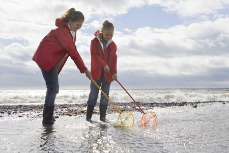 studied: Mother and daughter fishing with fishnet