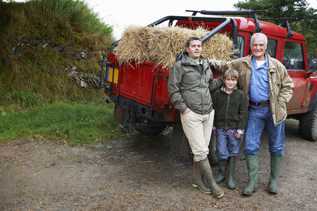 leaning on the truck: Family with 4x4 Landrover