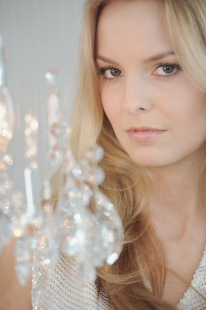 attractiveness: Woman with crystal chandelier