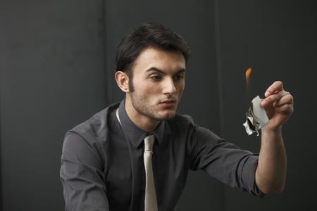 blazed: Businessman burning paper