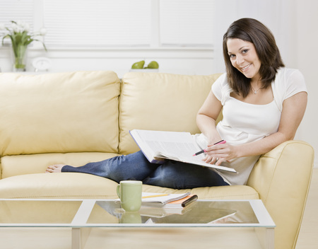 drawing room: Woman studying on couch