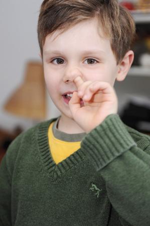 nose picking: Boy picking his nose