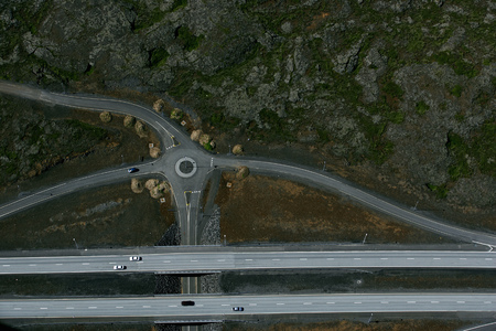 curve road: Aerial view of freeway and roundabout LANG_EVOIMAGES