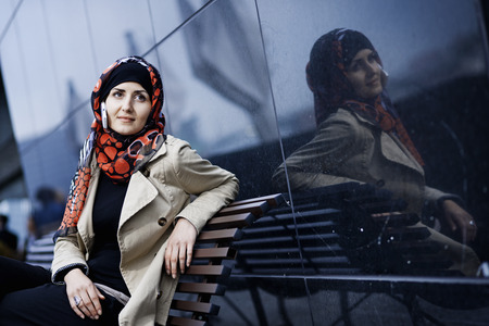 handsfree telephones: Woman with cell phone in headscarf