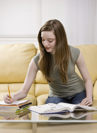 notations: Girl studying in living room