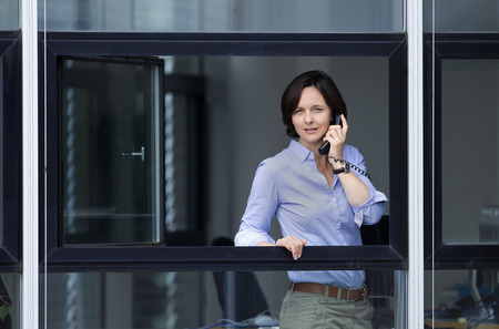 consulted: Businesswoman looking out office window