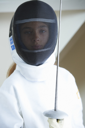 Girl in fencing costume holding sword