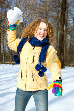 mischeif: Girl throwing a snowball