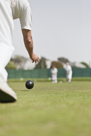 60 64 years: Older man lawn bowling