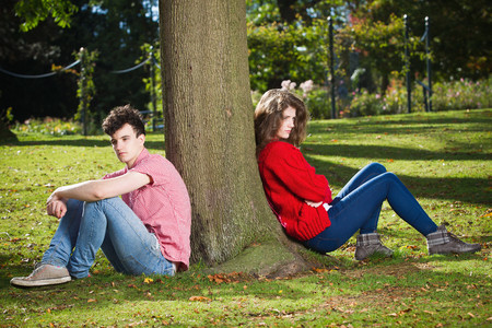 disagreed: Teenage couple arguing in park