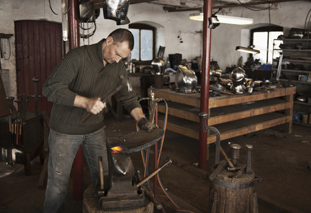 histories: Blacksmith at work in shop