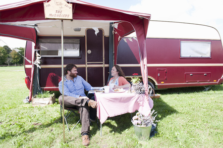 picnicking: Couple picnicking outside trailer