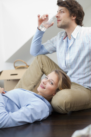 moving box: Couple relaxing together on floor