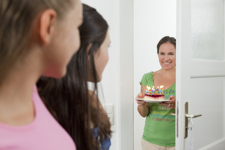 blazed: Mother with birthday cake for daughter