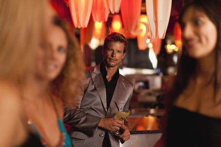 Man admiring women in bar