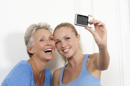 female likeness: Mother and daughter taking photo