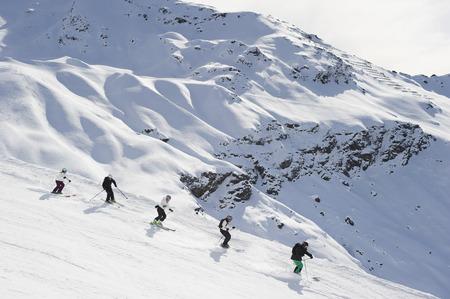 Skiers skiing together on slope LANG_EVOIMAGES